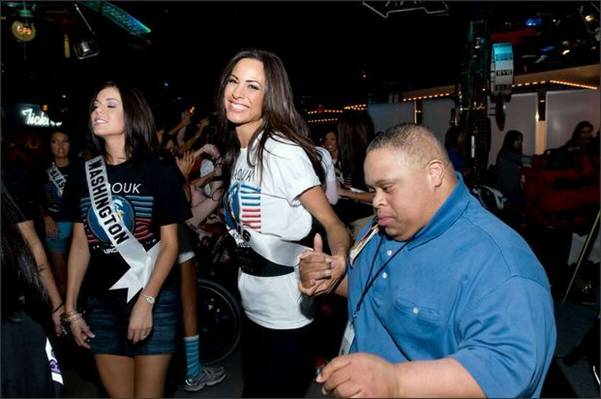 Michelle Font and Shanon Lersch, Miss Illinois USA 2008, show off their best dance moves during the Miss USA/Best Buddies Nevada