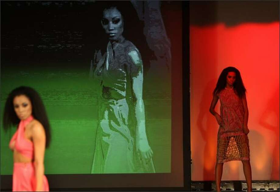 Model and audio production student at Art Institute of Seattle Chanelle Ray, left, and Shaleia Rich, of Maple Valley, walk the runway during the Underground Couture Fashion Show, presented by the Art Institute of Seattle. they are wearing fashion designs by Natalia Markova. Photo: Mike Kane, Seattle Post-Intelligencer
