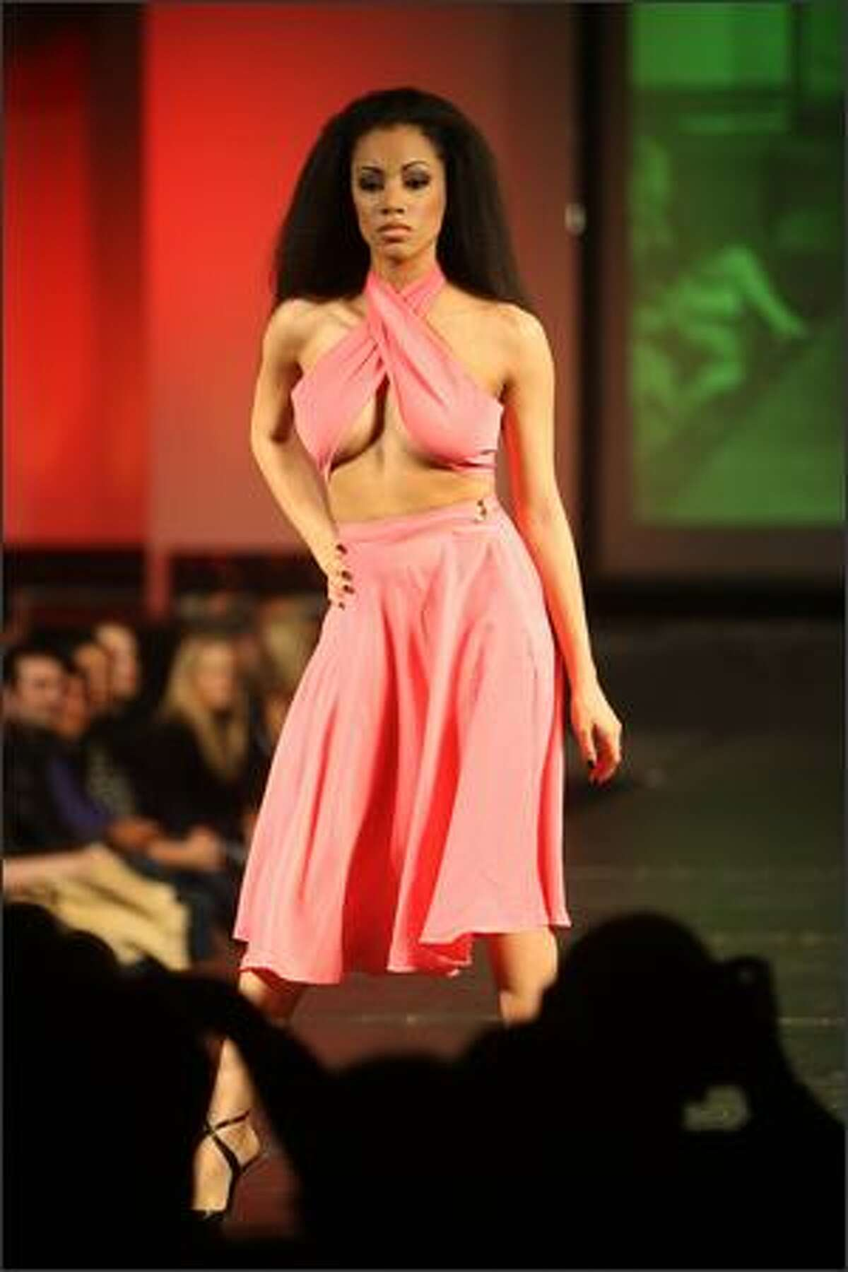 Model and audio production student at Art Institute of Seattle Chanelle Ray walks the runway in a dress designed by Natalia Markova during the Underground Couture Fashion Show.