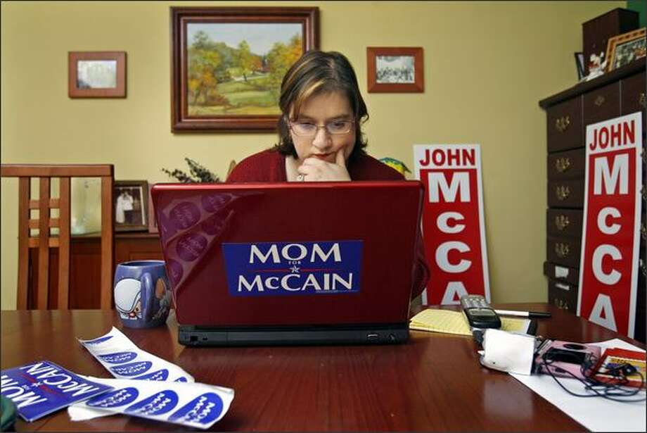 A fan of John McCain, Jean Avery works on Moms4McCain.blogspot.com in her Redmond home. Hers is one of many unofficial sites to jump into the political fray. Photo: Dan DeLong/Seattle Post-Intelligencer