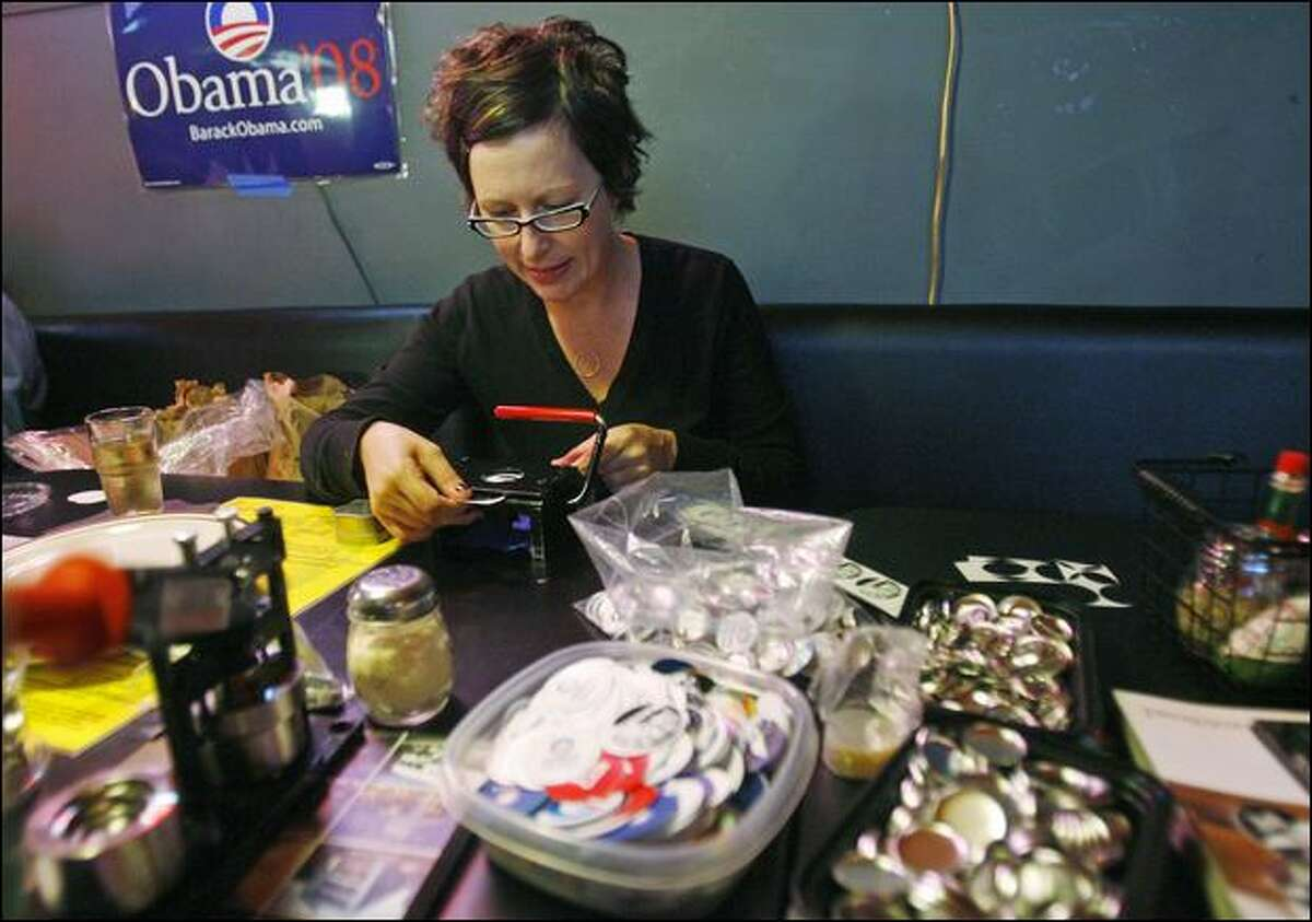 Barack Obama supporter Erin Byrnes of Judkins Park makes buttons Wednesday at Stellar Pizza in Georgetown. Buttons4obama.com offers pro-Obama button templates online.