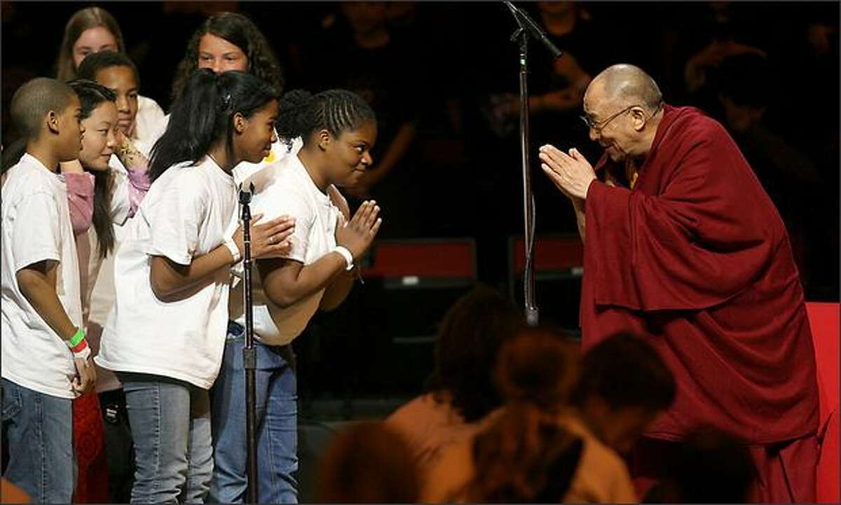 The Youth Ambassadors are greeted by the Dalai Lama following their performance at Key Arena.