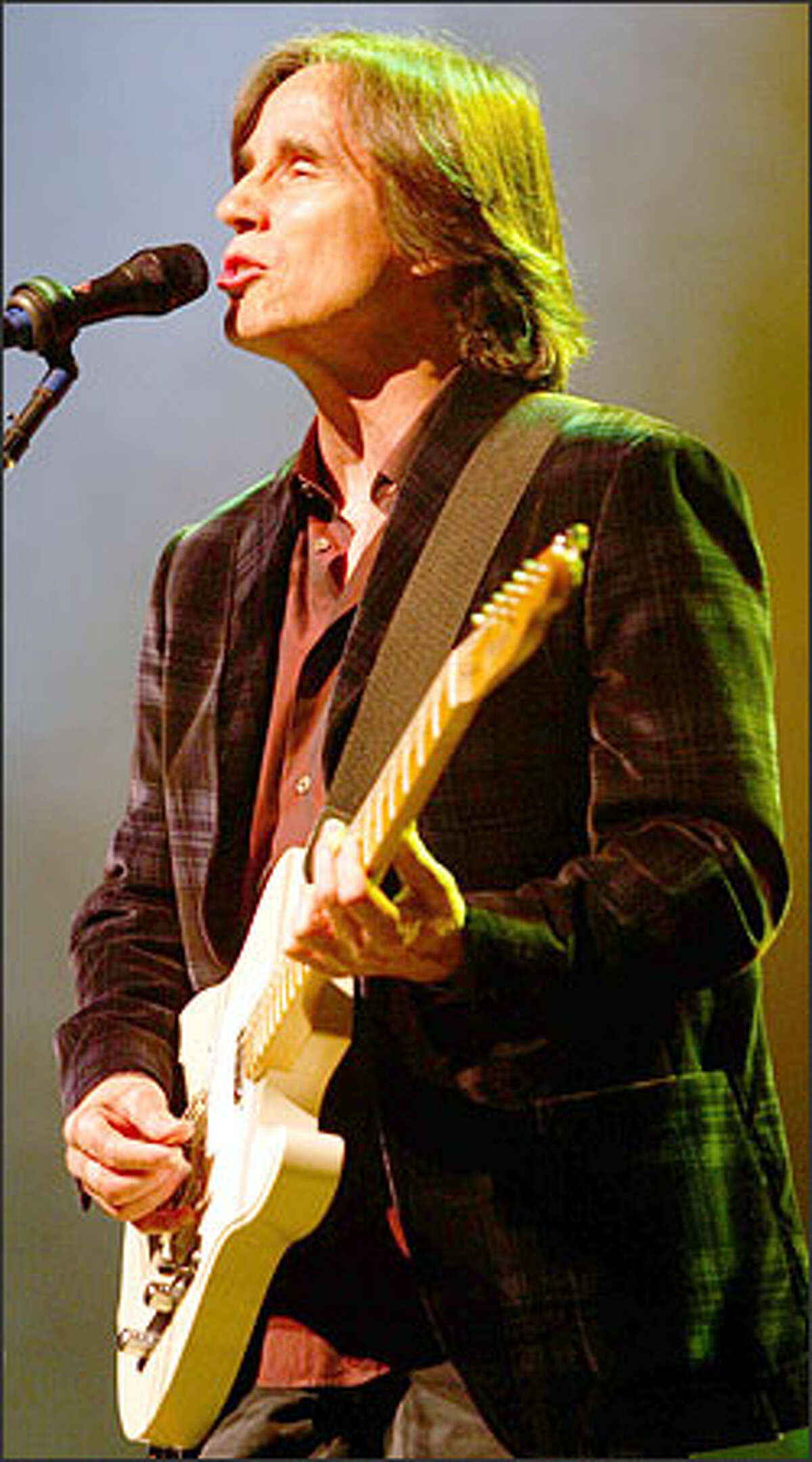 Jackson Brown performs at the Tacoma Dome as the opening band for Tom Petty and the Heartbreakers.