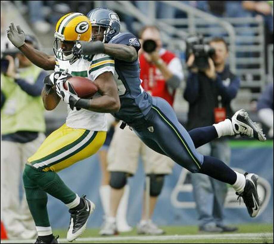 Cornerback Marcus Trufant is unable to stop the Packers' Greg Jennings from pulling in a 45-yard touchdown reception in the third quarter at Qwest Field on Sunday. Photo: Dan DeLong/Seattle Post-Intelligencer