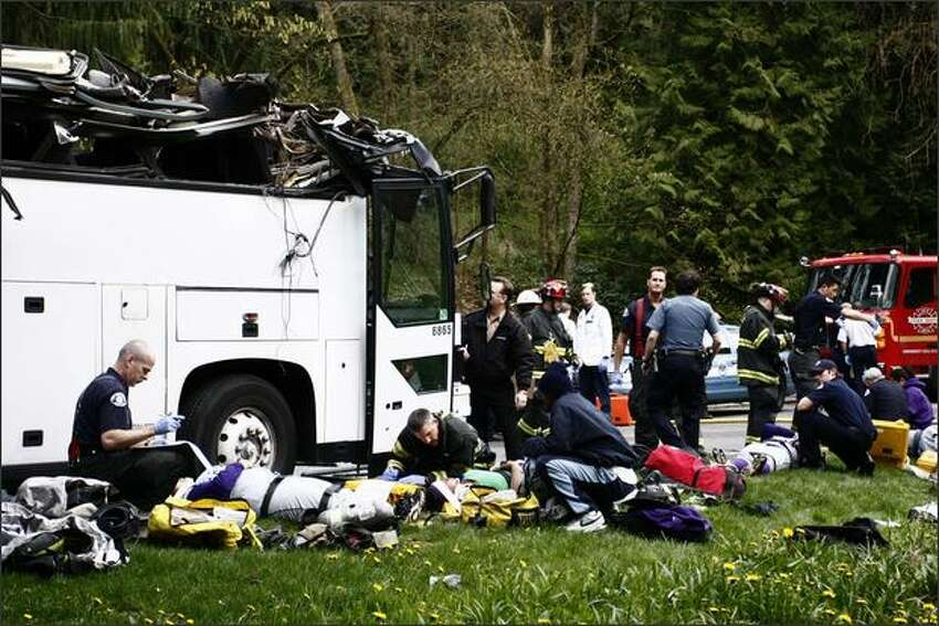 A charter bus carrying the Garfield High School girls' softball team smashed into an overpass in Seattle, destroying the roof and slightly injuring at least five students. The bus was carrying 24 Garfield High School students, their coach and a driver, said Seattle Fire Department spokeswoman Helen Fitzpatrick.
