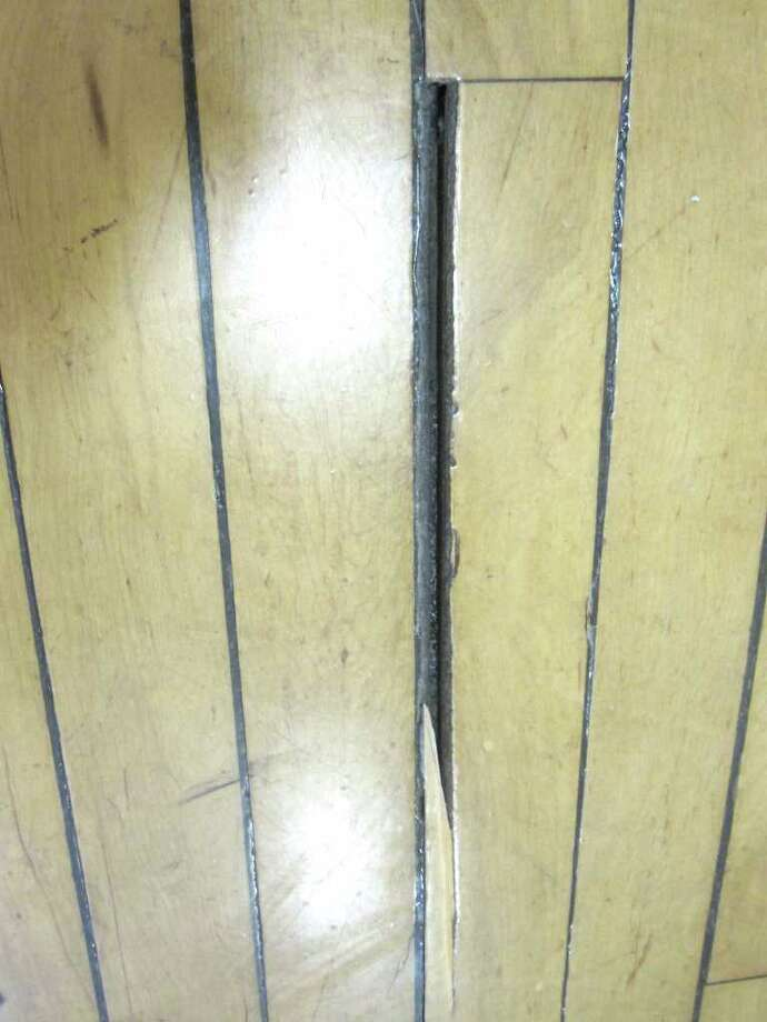 The Middlesex Middle School gym will finally see some repairs after the RTM approved an early allocation to replace the floor, bleachers and dividing doors. Photo: Contributed Photo / Darien News