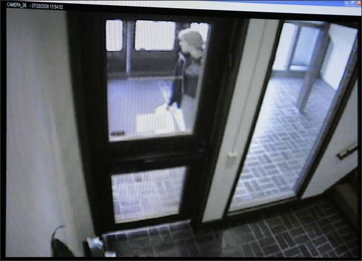 Surveillance footage recorded by security cameras at the Jewish Federation of Greater Seattle on July 28, 2006, shows Kelsey Burkum speaking with Naveed Haq befor he followed her into the building. The footage was offered as evidence in the trial against Haq at the King County Courthouse. Haq is accused of killing one woman and wounding five during the shooting.