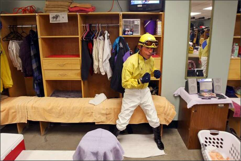 Horse jockey Gerardo Gavica shadow boxes while getting ready to ride before the start of the first race at Emerald Downs on opening night of the 2008 racing season in Auburn, Wash. Photo: Mike Kane, Seattle Post-Intelligencer