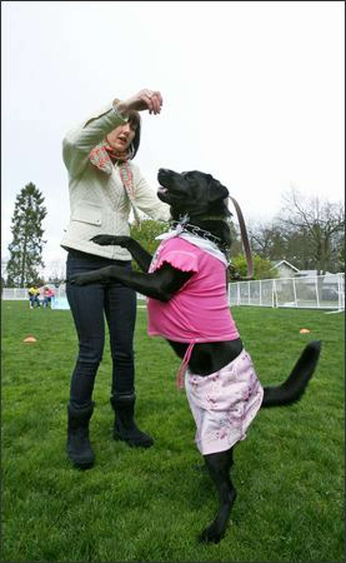 Blythe Simmons of West Seattle encourages Frieda, a Lab mix, to dance.
