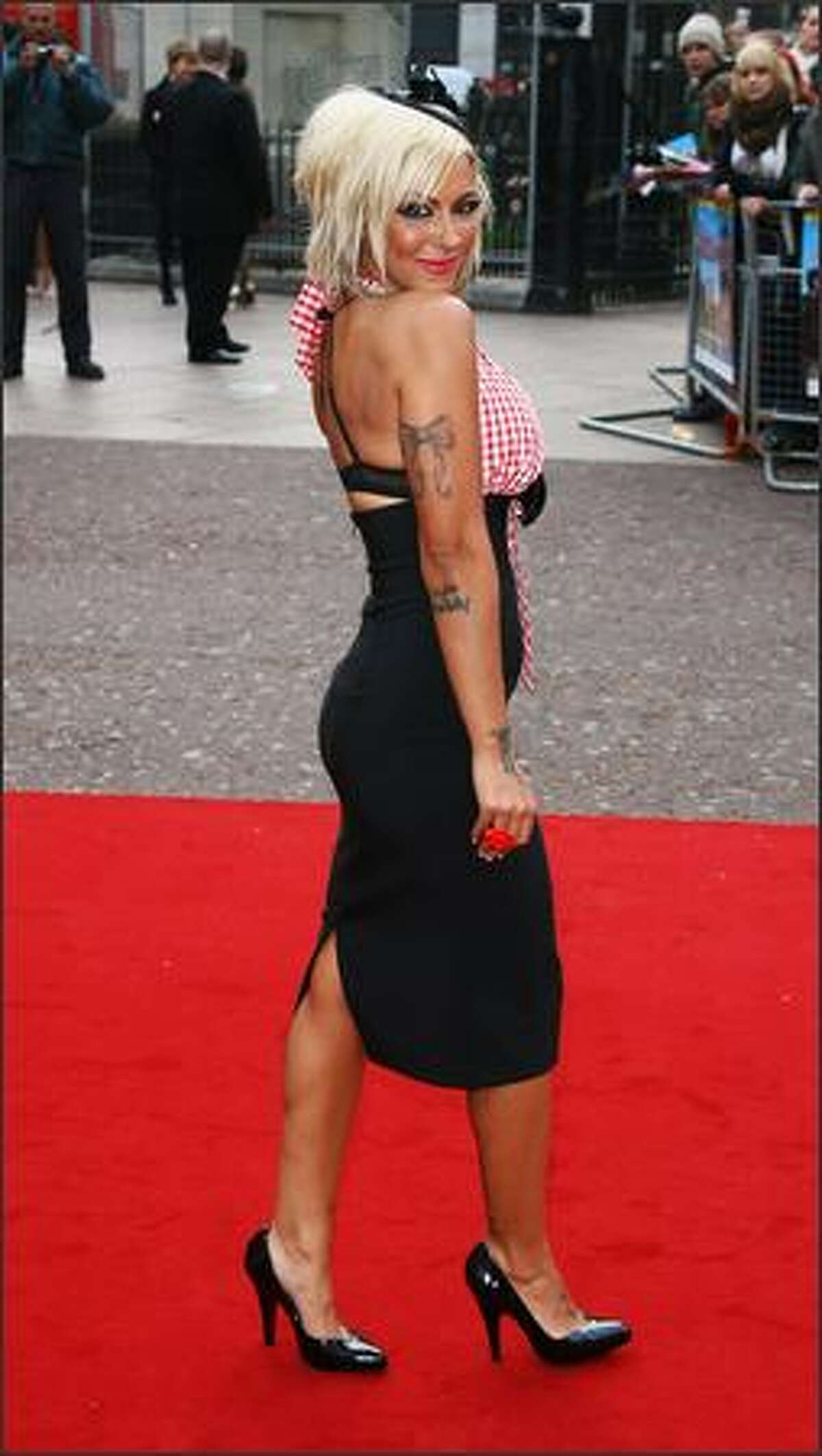 Model Jodie Marsh arrives at the World Charity Premiere Of 'Three And Out' at the The Odeon, Leicester Square on Monday in London, England.