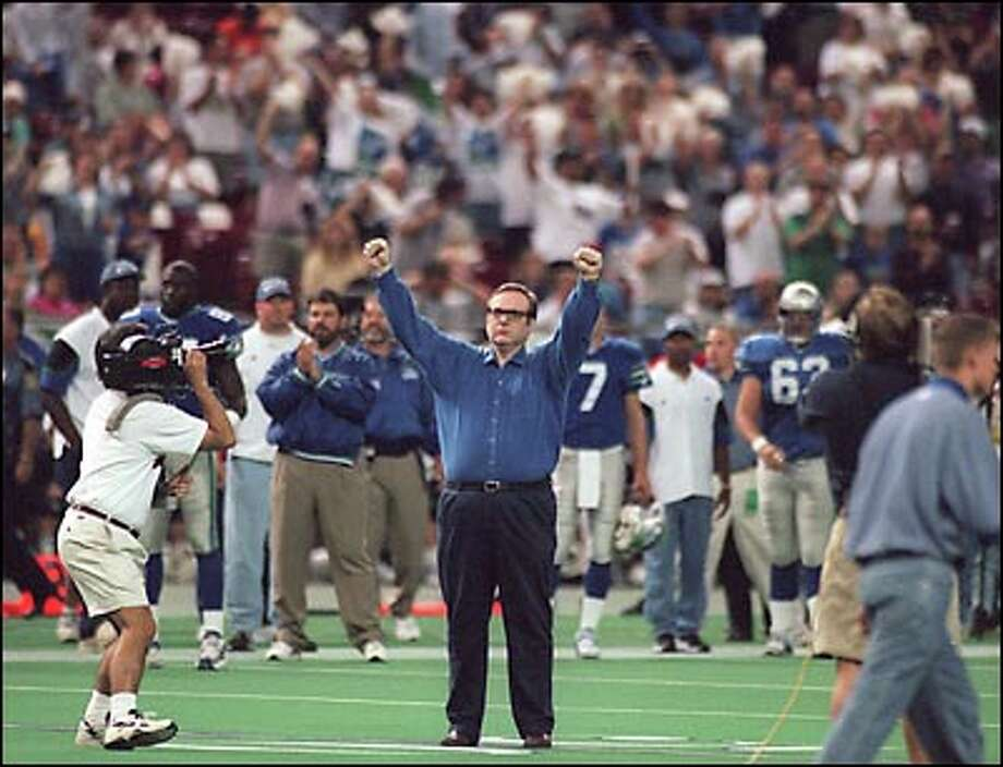 Billionaire Paul Allen, the new owner of the Seahawks, is introduced to the fans before a Seahawks-Jets game.  Allen bought the team from Ken Behring and promised to keep it in Seattle.  One condition, though, was that a new stadium be built for the team, signaling the end of the Kingdome. Photo: Grant M. Haller, Seattle Post-Intelligencer