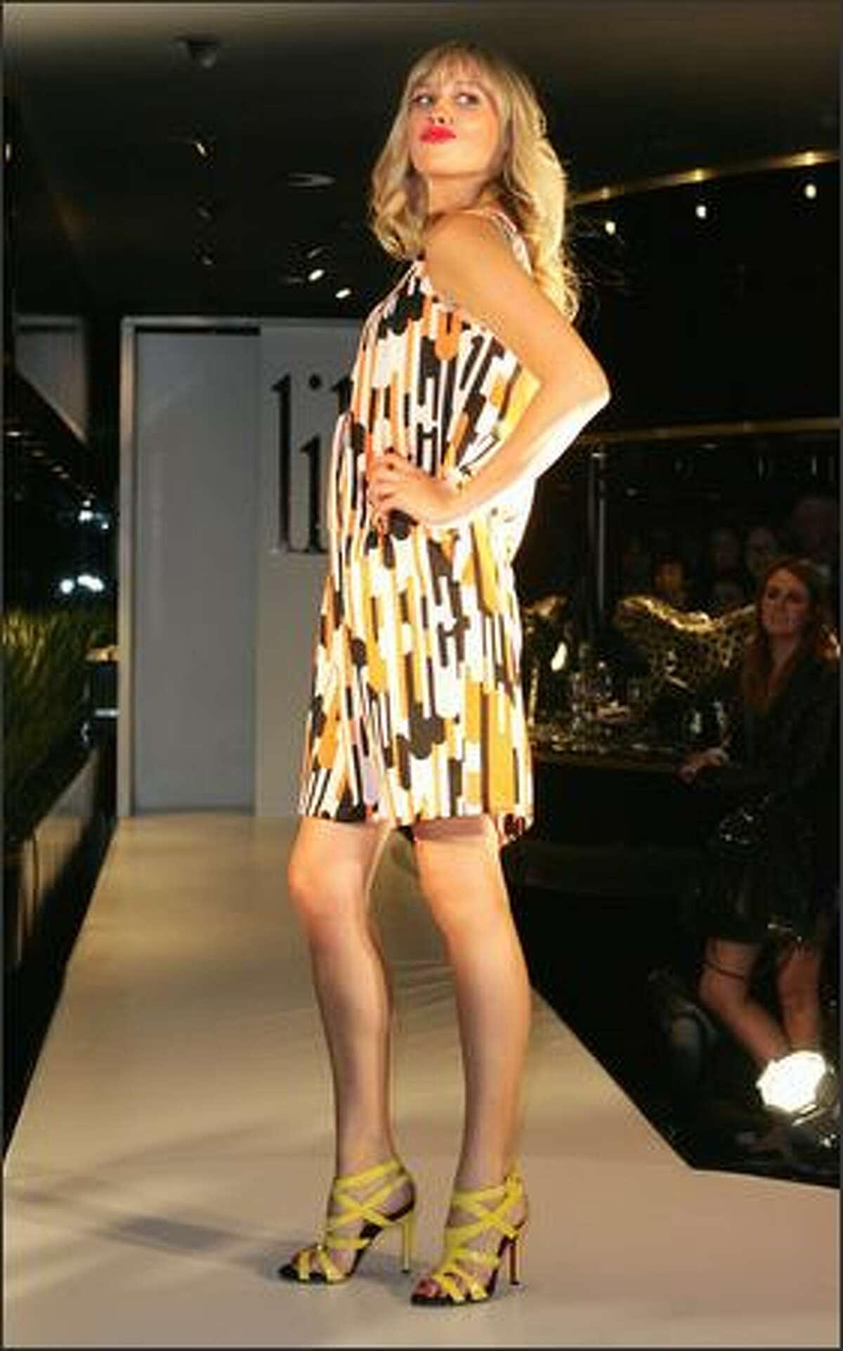 A model showcases an outfit by designer Lili during the official launch party for Lili Summer's new collection