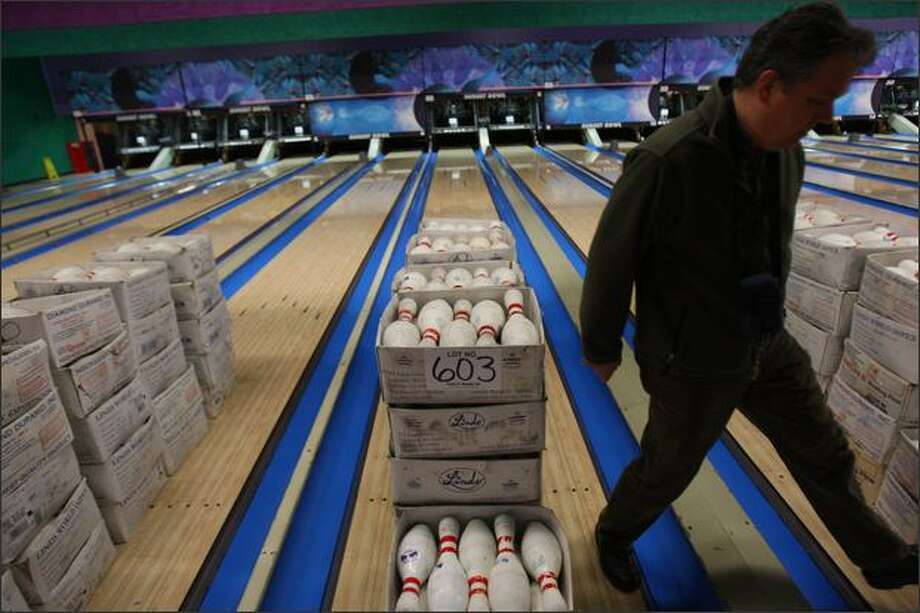 Boxes of bowling pins, along with nearly everything else from kitchen equipment to pin setter machinery, is up for sale at Sunset Bowl during an auction put on by James G. Murphy Inc. Photo: Mike Kane, Seattle Post-Intelligencer