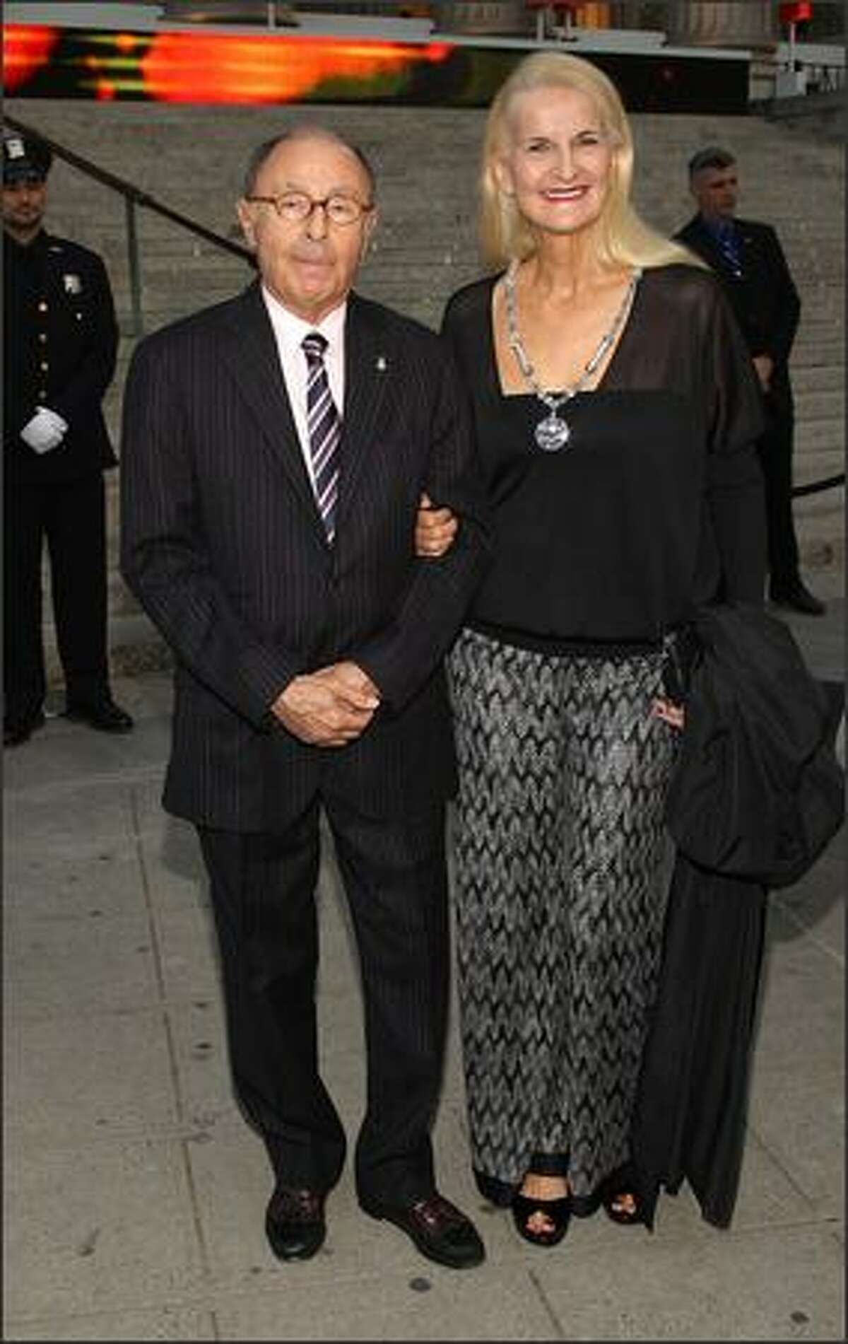 Editor-In-Chief of Variety Peter Bart and Phyllis Fredette arrive.