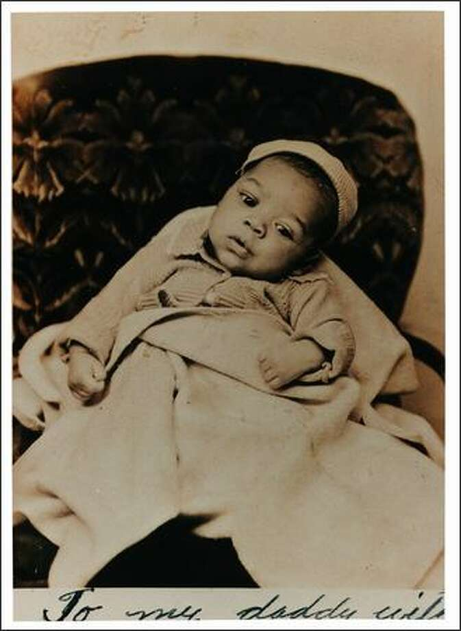 "Photograph of Jimi Hendrix as a baby. Part of the the EMP's ""Jimi Hendrix: An Evolution of Sound"" exhibit.