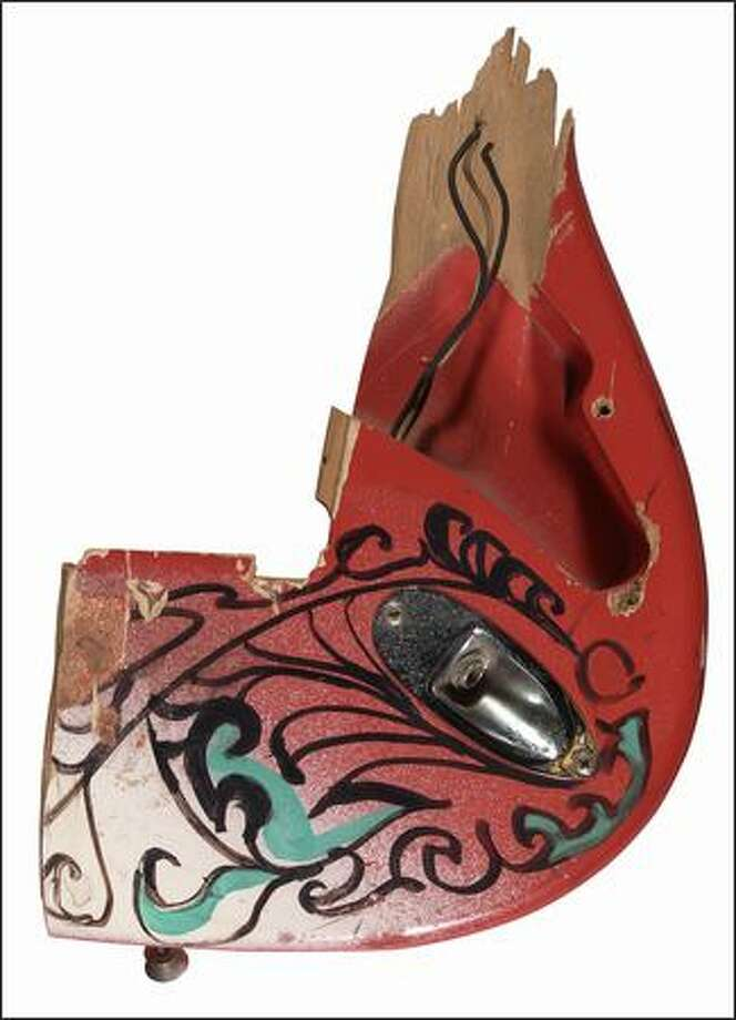 """Fender Stratocaster fragment: smashed and burned by Jimi Hendrix at the Monterey International Pop Festival, 1967. Part of the the EMP's """"Jimi Hendrix: An Evolution of Sound"""" exhibit.  Photo courtesy of Experience Music Project"""