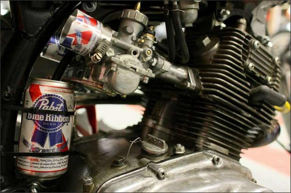 An oil vapor catch can, made of a Pabst beer can, adds some character to a cafe racer motorcycle at Twinline Motorcycles.