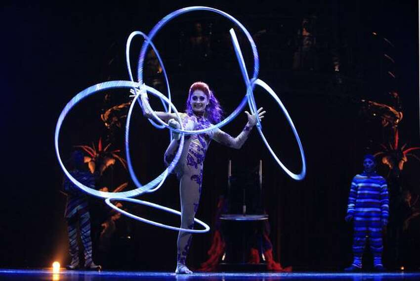 Irina Akimova twirls with seven hoops during a performance of Cirque du Soleil's KOOZA.