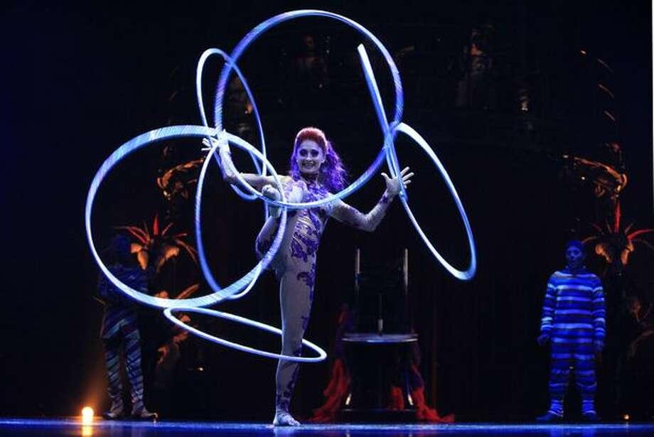 Irina Akimova twirls with seven hoops during a performance of Cirque du Soleil's KOOZA. Photo: Joshua Trujillo, Seattlepi.com