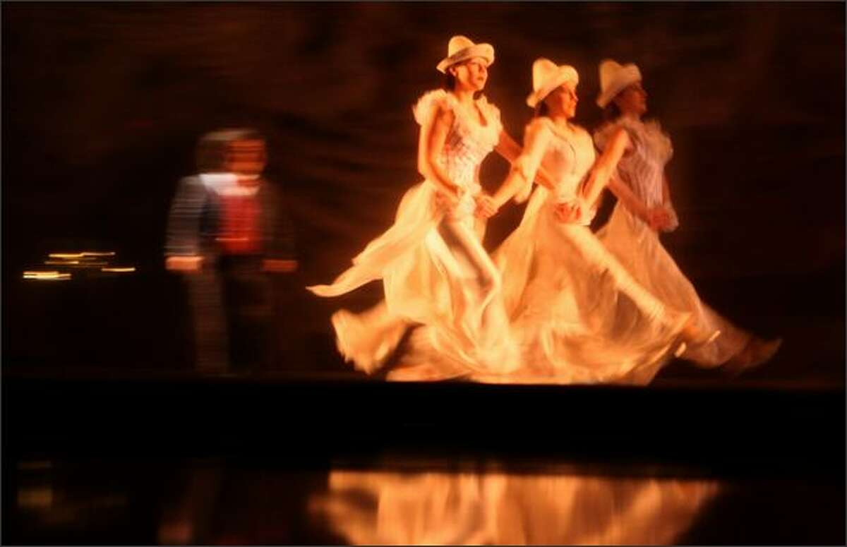 Members of Cirque Du Soleil take the stage during a showing of Corteo.