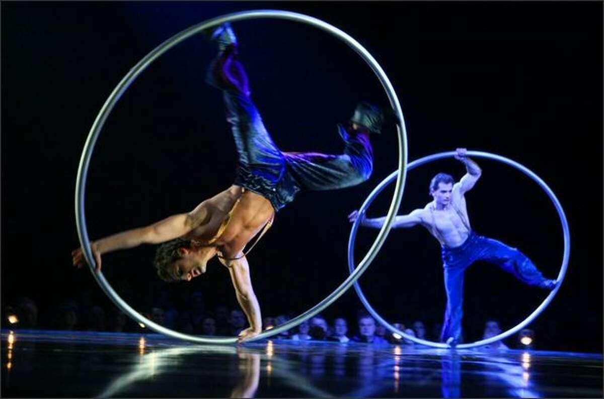 Members of Cirque Du Soleil perform the Cyr Wheel.
