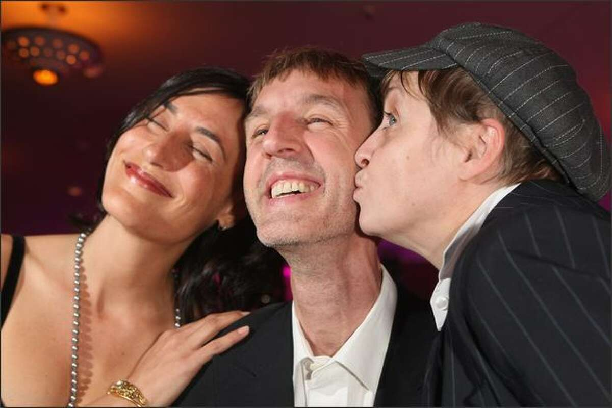 Actor Anndreas Schmidt gets a kiss from actress Katharina Thalbach (R) and attention from his girlfriend Jennifer at the afterparty at the German Film Award 2008 (Deutscher Filmpreis 2008) at the Palais am Funkturm on Friday in Berlin, Germany.