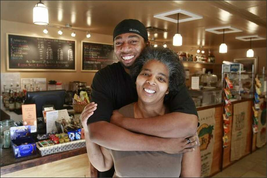"Illume Miller and her son, Gary Grant, and three other family members joined forces to open Grown Folks Coffeehouse last July. Miller makes a creamy, tangy, sweet dressing that's a family favorite. ""These guys have been trying to get me to bottle it for years,"" she says. Photo: Meryl Schenker/Seattle Post-Intelligencer"
