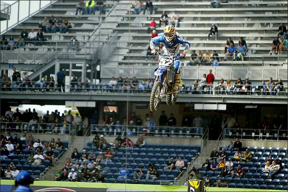 Matt Lemoine gets some air during a qualifying practice as the AMA Supercross series comes to Qwest Field in Seattle on Saturday. Photo: Scott Eklund, Seattle Post-Intelligencer