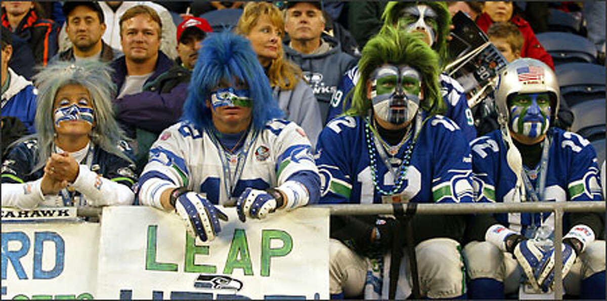 These fans dressed the part at Seahawks Stadium, but had little to cheer about as Seattle managed just three field goals, totaled a scant 204 yards of total offense, and fell to 3-7.