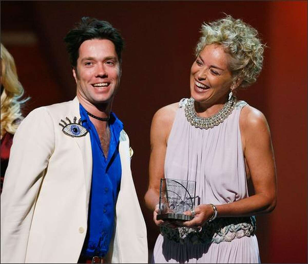 Singer Rufus Wainwright accepts the Stephen F. Kolzak Award from actress Sharon Stone onstage at the 19th Annual GLAAD Media Awards on April 26, 2008 at the Kodak Theatre in Hollywood, California.