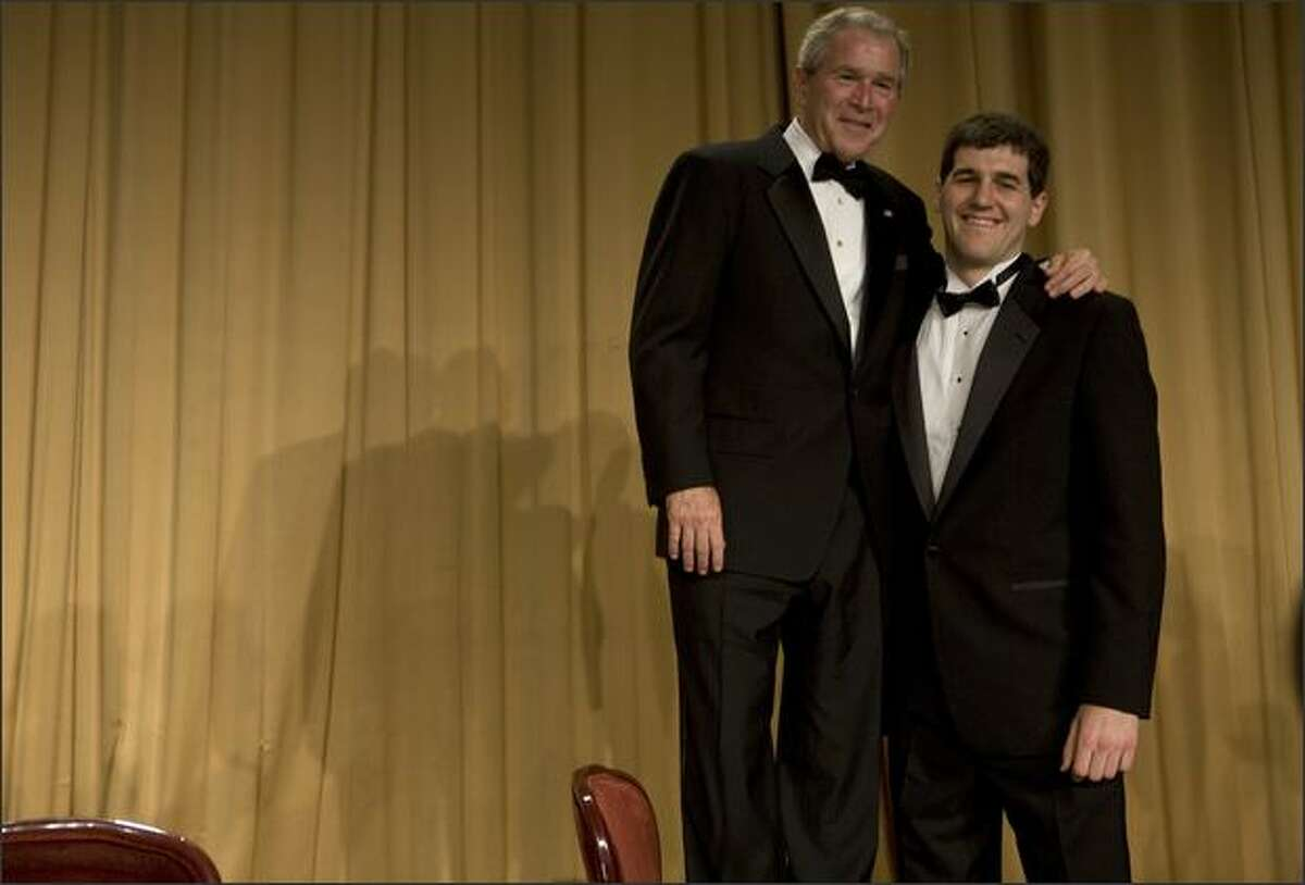 President George W. Bush (L) poses with Deborah Orin Scholarship award winner David Rivelli during the White House Correspondents' Association Dinner at the Washington Hilton April 26, 2008 in Washington, DC.