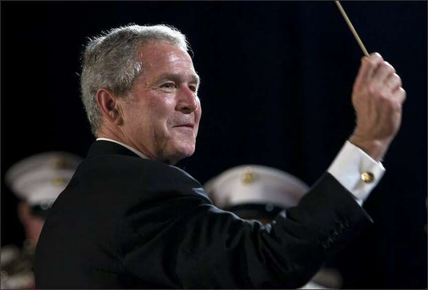 President George W. Bush conducts the Marine Corps Band during the White House Correspondents' Association Dinner at the Washington Hilton April 26, 2008 in Washington, DC.