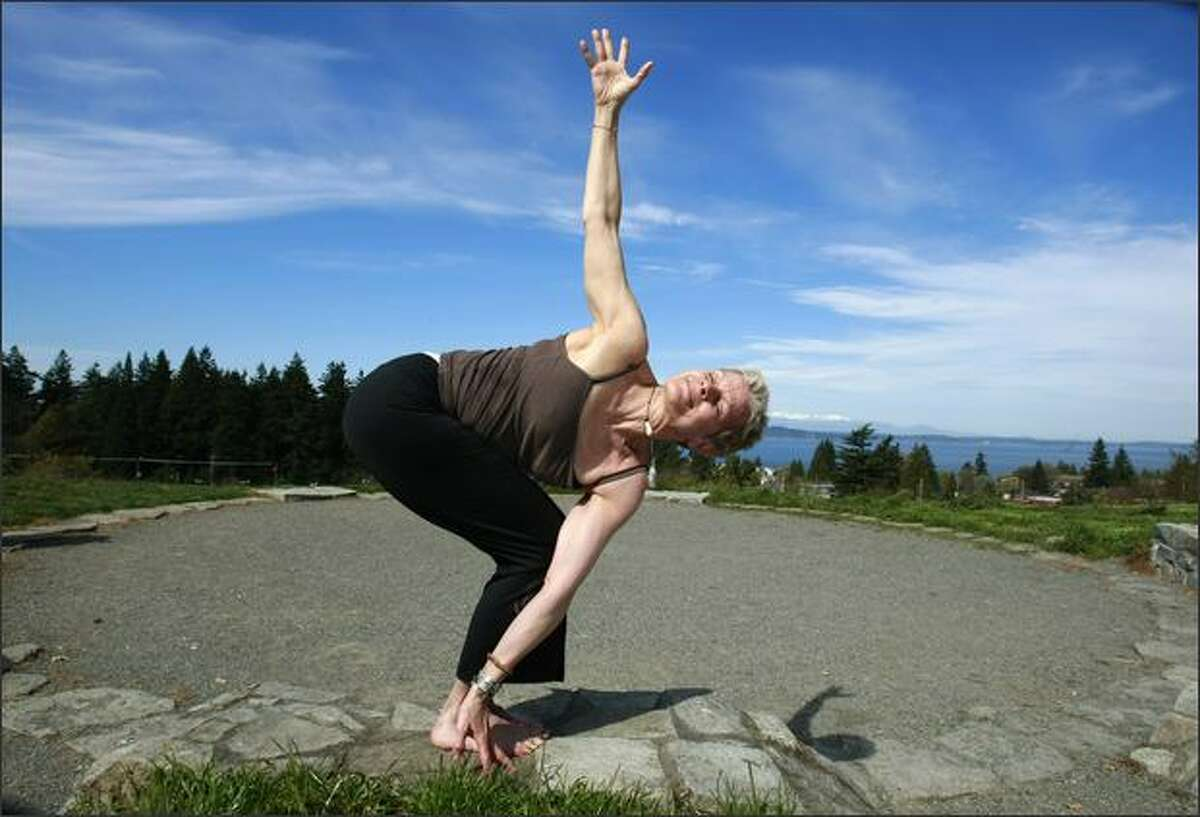 Denise Carrico, 56, of Seattle, has been practicing yoga for 30 years. It takes mental and physical power to balance yourself in this pose. Yoga is also known for its healing power.
