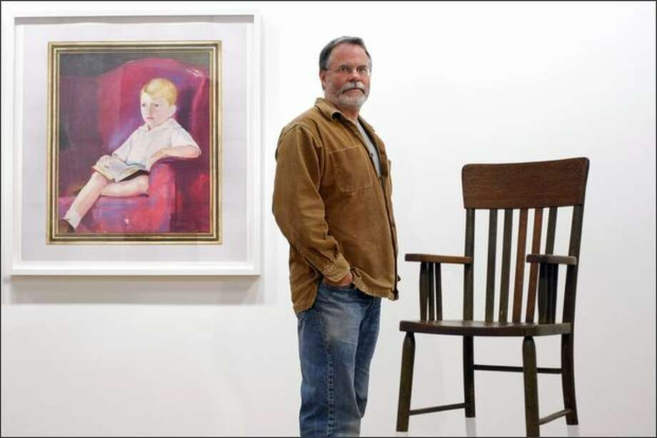 "Seattle artist Roy McMakin poses with details of two works: ""6 Photographs of a Painting of a Boy I Bought at an Antique Mall,"" left, and an untitled piece. Photo: Andy Rogers/Seattle Post-Intelligencer"
