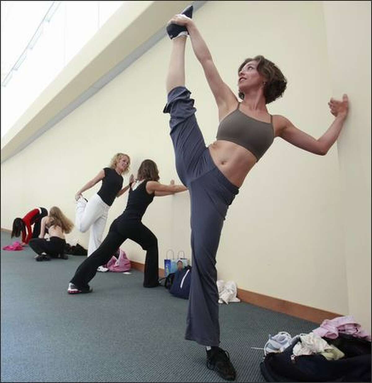 Sarah Frewen, 28, of Mountlake Terrace, stretches before her audition for the Seattle Seahawks cheerleader squad, the Sea Gals.