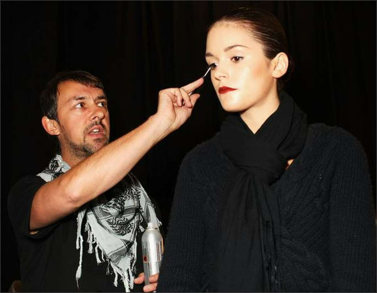 A model has her hair styled backstage ahead of the Lisa Ho show.