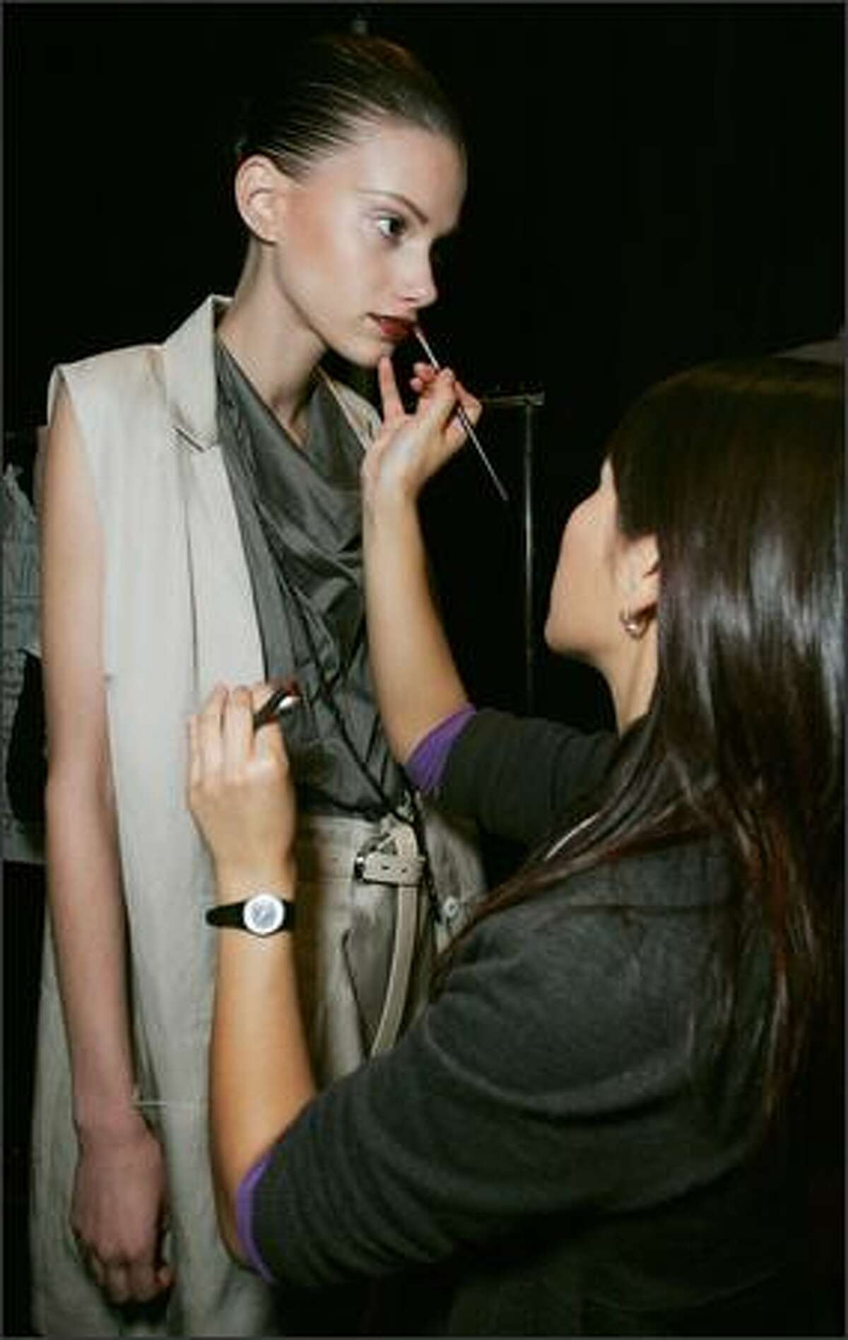 A model has make-up applied backstage ahead of the Lisa Ho show.