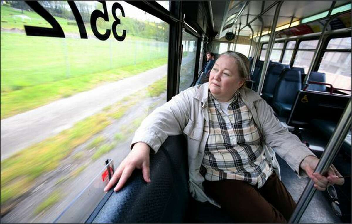 Maggieh Rathbun takes the bus from her home off Delridge to to do her grocery shopping at the PCC in West Seattle.