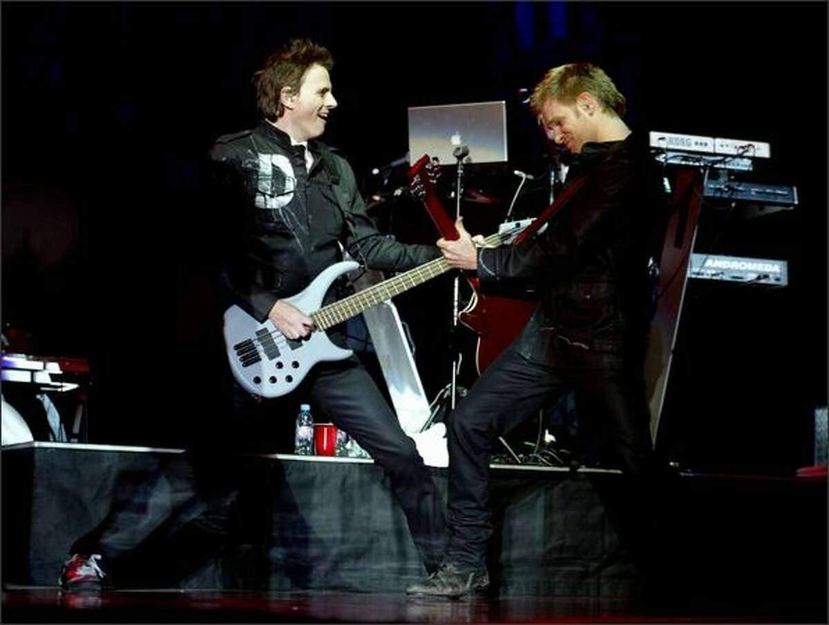 John Taylor bass guitar left and Dominic Brown lead guitar right with Duran Duran perform at the WaMu Theater in Seattle. [Note: This cutline has been changed since it was originally published.]