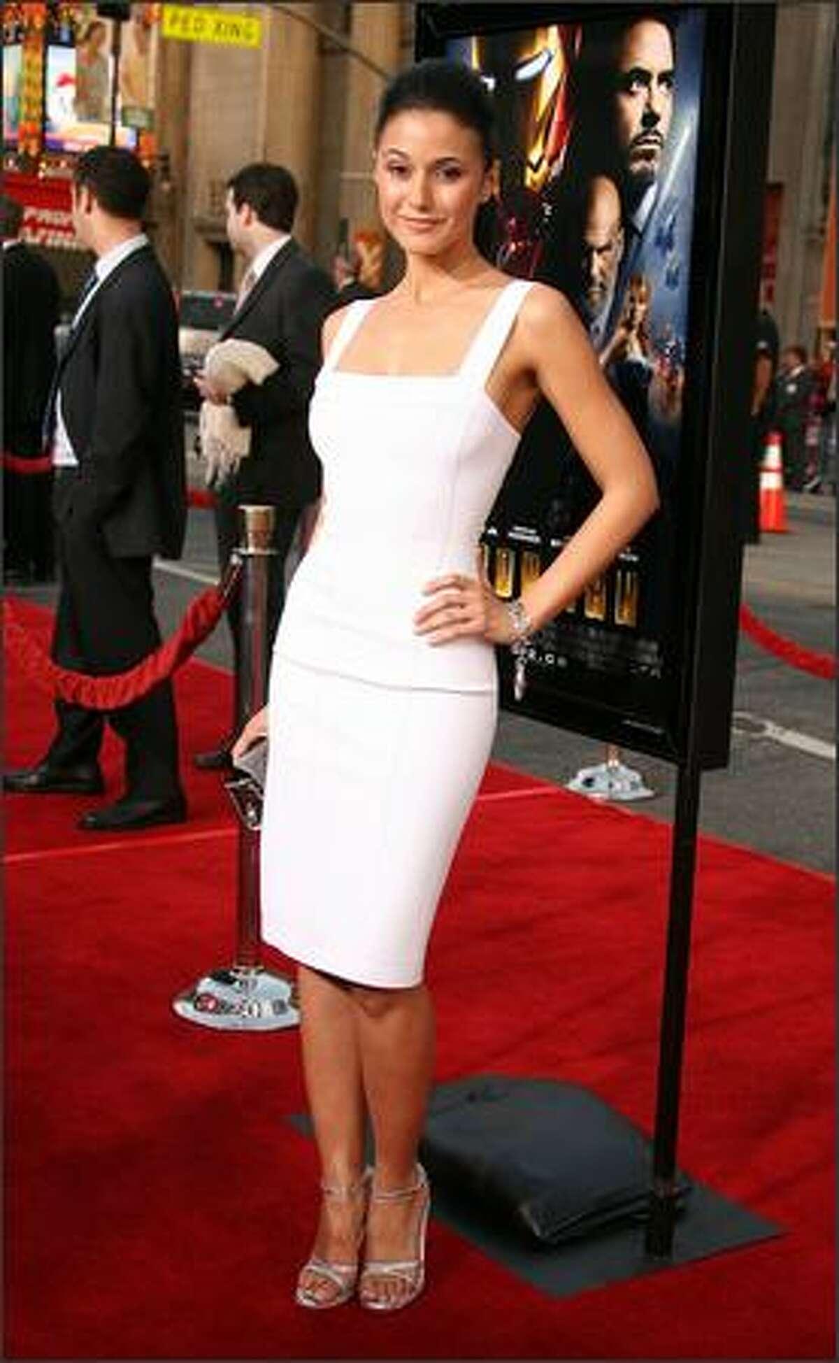 Actress Emmanuelle Chriqui arrives.