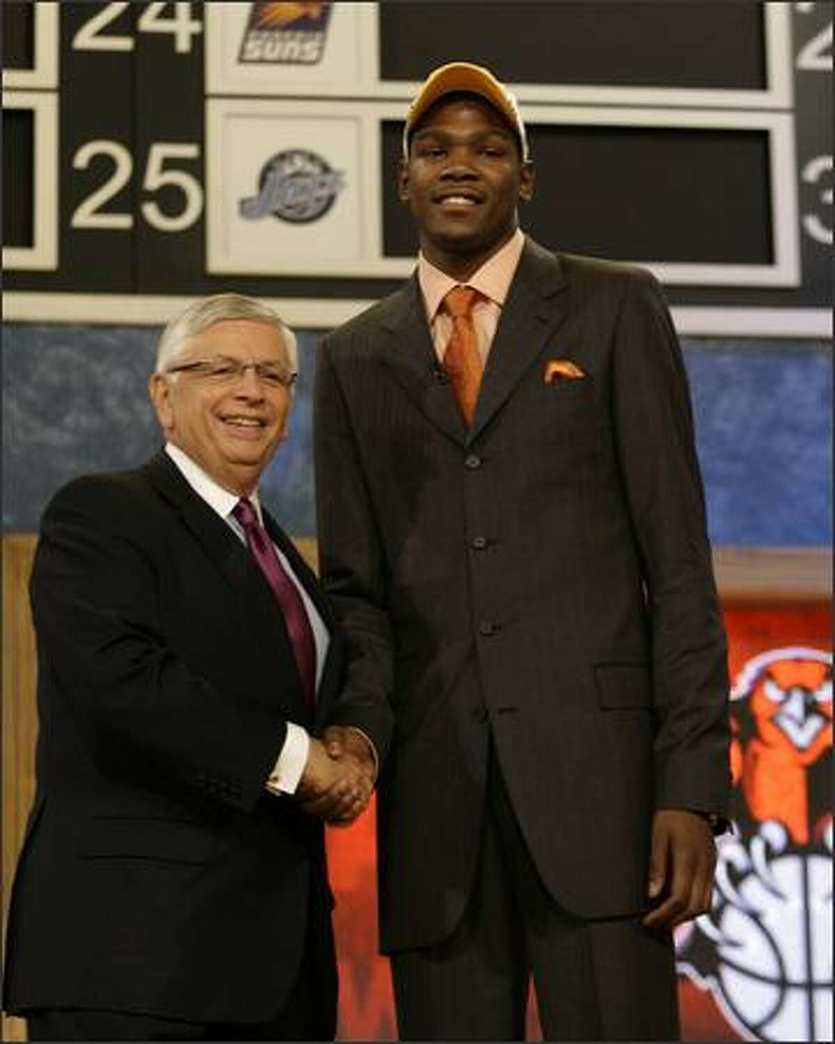 Texas' Kevin Durant, right shakes hands with NBA commissioner David Stern after being selected by the Seattle SuperSonics as the second overall pick in the 2007 NBA Draft, Thursday, June 28, 2007, in New York. (AP Photo/Kathy Willens)