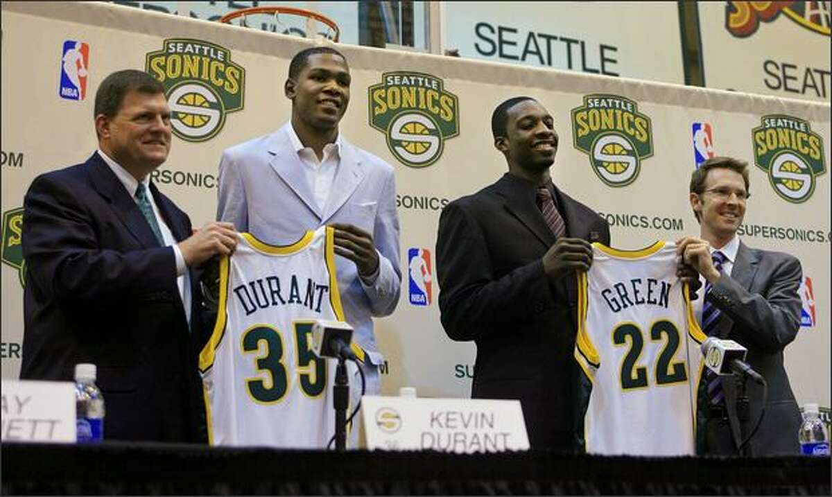 New Seattle Sonics players Kevin Durant and Jeff Green are introduced by team owner Clay Bennett (left) and GM Sam Presti during a news conference at the Furtado Center in Seattle on Friday, June 30, 2007.