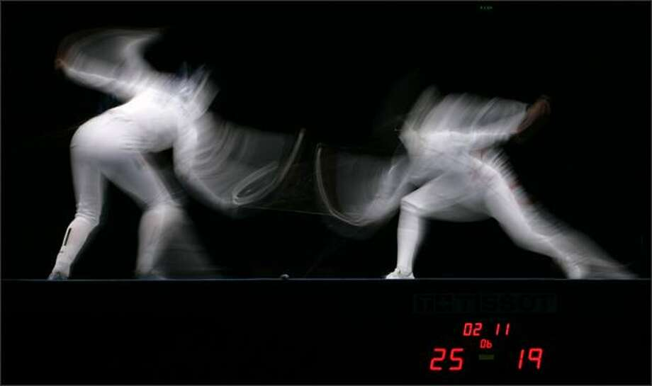 (1) Imke Duplitzer, of Germany, left, competes against, Danuta Andrezejuk, of Poland, in the bronze medal match in the Women's Team Epee at the 2008 FIE World Championships at the Fencing Hall, Saturday, April 19, 2008, in Beijing. (AP Photo/Robert F. Bukaty)