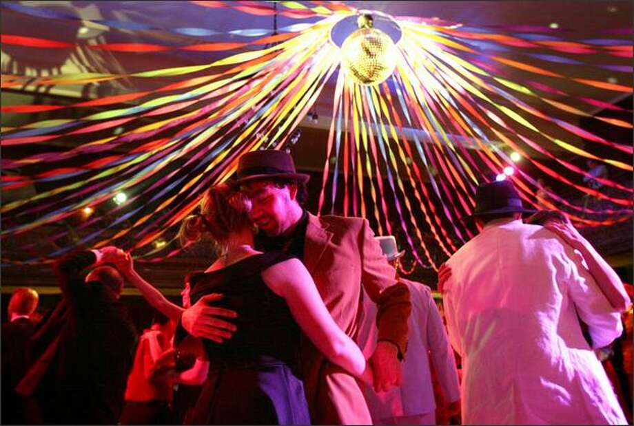 In this 2008 picture, Steven Stevenson and Sandra Morrow dance underneath the disco ball at Century Ballroom. Photo: Joshua Trujillo, Seattlepi.com