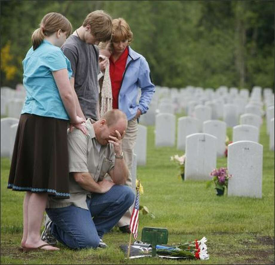 On Memorial Day, hundreds of families came to Tahoma National Cemetery to visit the graves of loved ones. More than 20,000 are buried at Tahoma. Photo: Paul Joseph Brown, Seattle Post-Intelligencer