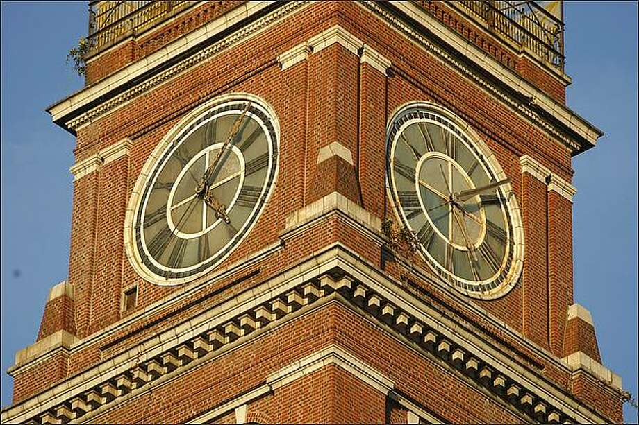 The clocks on the King Street Station tower are running on time again, thanks to two volunteer clock hobbyists. Photo: Andy Rogers/Seattle Post-Intelligencer