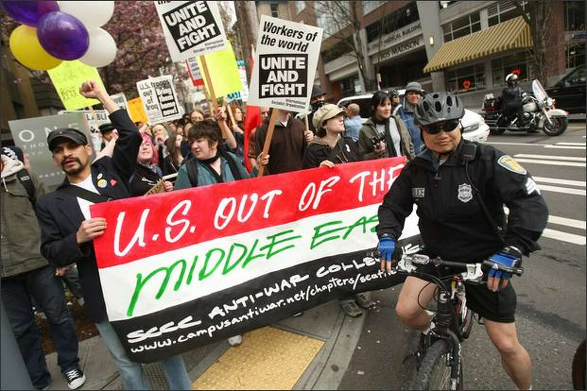 """Seattle Central Community College students march together from their campus on Capitol Hill to Alaskan Way during the """"May Day March and Rally"""" in Seattle."""