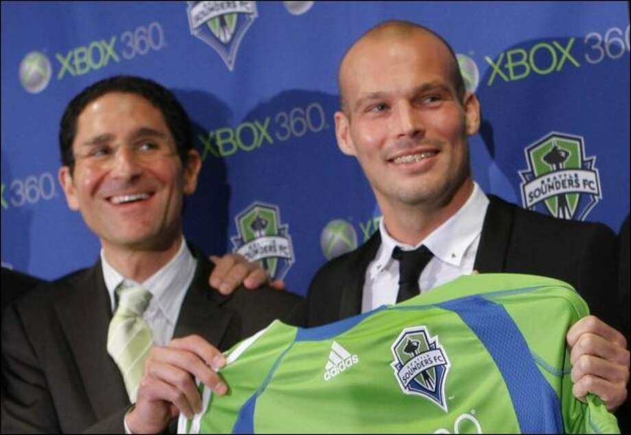 Freddie Ljungberg, right, is introduced to the media as Seattle's newest acquisition Tuesday by general manager Adrian Hanauer. Photo: Andy Rogers/Seattle Post-Intelligencer