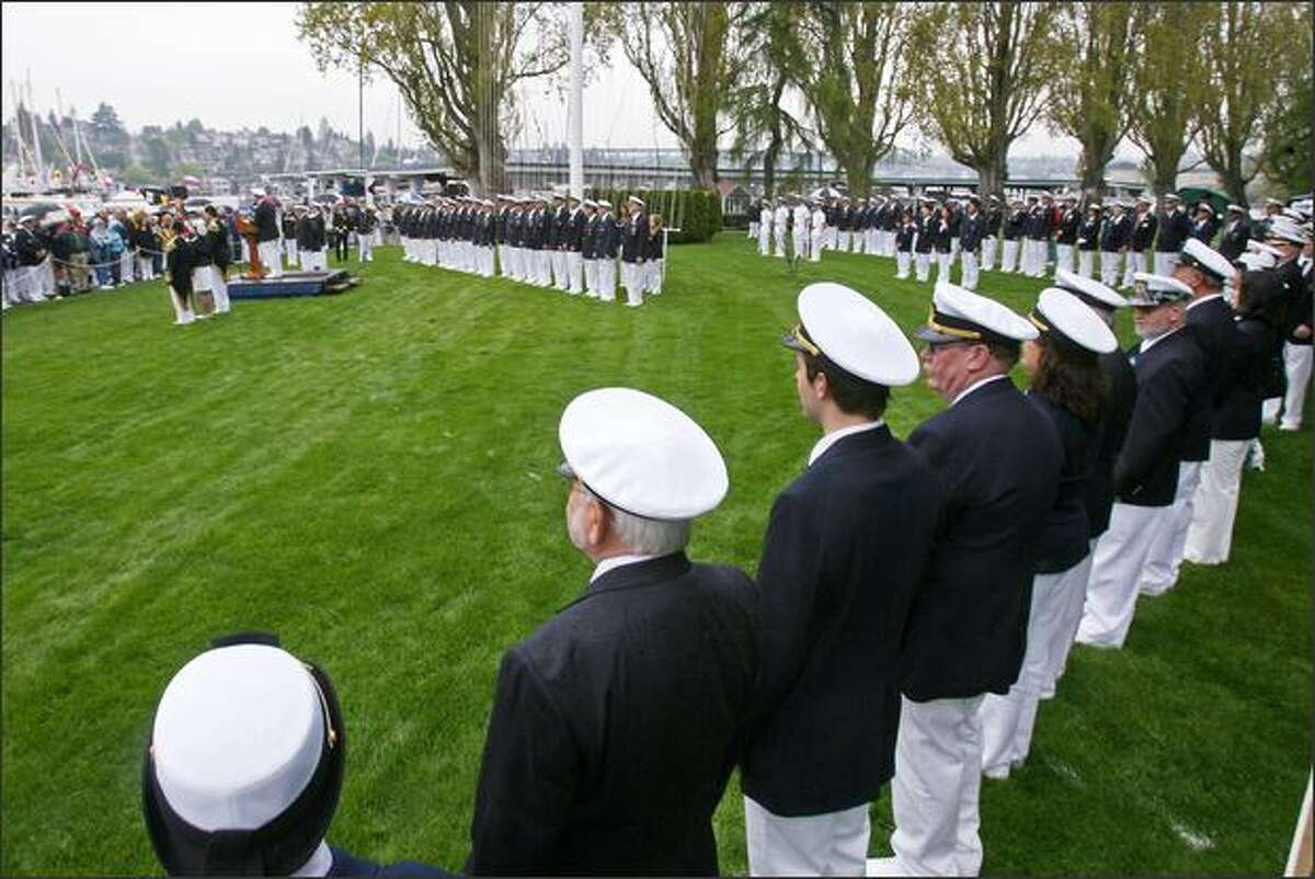 The commissioning ceremony takes place on the lawn of the Seattle Yacht Club on Opening Day of boating season at the Montlake Cut in Seattle.