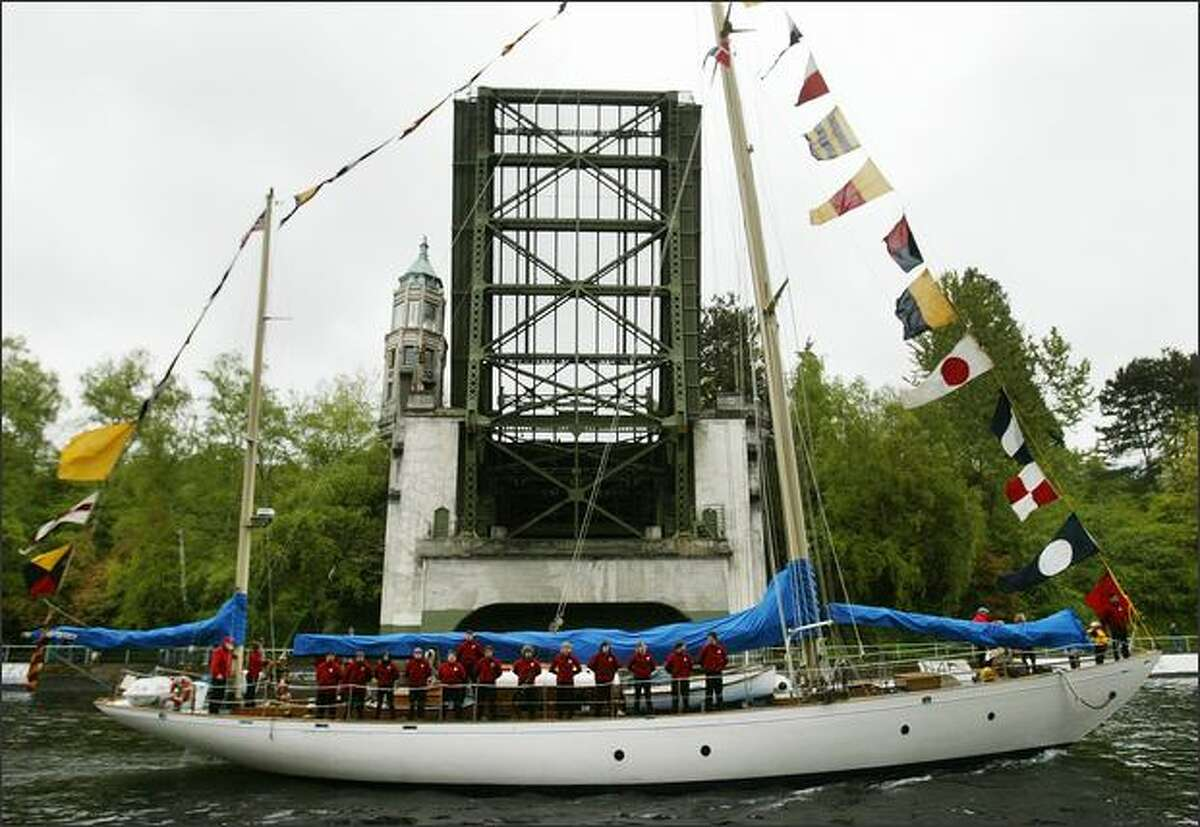 The sailboat Odyssey passes under the Montlake Bridge during the